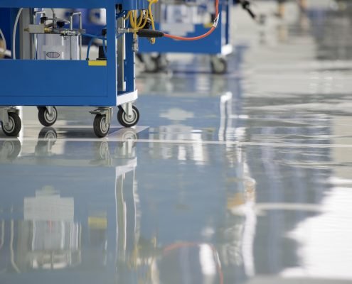 Self-leveling epoxy coating creates a smooth and seamless floor.