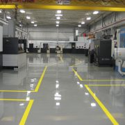 In industrial spaces like warehouses, a reflective resin flooring brightens the space, making them safer to work in.