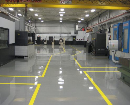 In industrial spaces like warehouses, a reflective epoxy floor coating brightens the space, making them safer to work in.