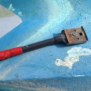 Removing antifouling paint with scraper