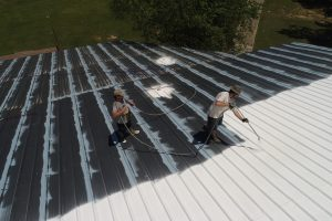 Applying roof paint New Zealand on flat roof
