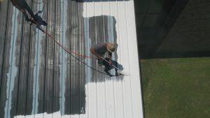 Applying white liquid Rubber coating NZ